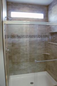 Shower with glass block transom